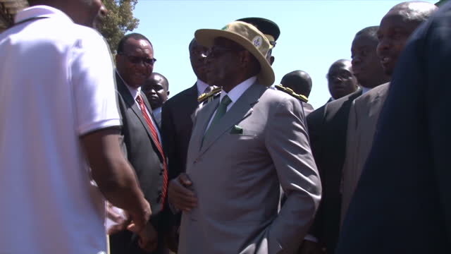 Shows exterior shots President Robert Mugabe at agricultural show on August 26 2016 in Harare Zimbabwe