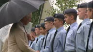 Shows exterior shots Prince Charles Prince of Wales and Camilla Duchess of Cornwall meeting Air training cadets and military personnel near...