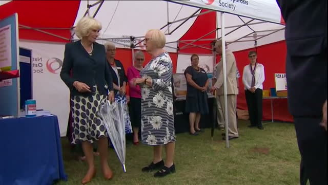 Shows exterior shots Prince Charles Prince of Wales and Camilla Duchess of Cornwall meeting stall holders at Sandringham Flower Show on 26th July...