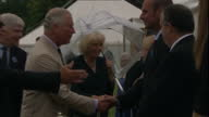 Shows exterior shots Prince Charles Prince of Wales and Camilla Duchess of Cornwall shaking hands with officials and presenting cups to winners at...