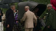 Shows exterior shots Prince Charles Prince of Wales and Camilla Duchess of Cornwall talking to officials getting in carriage and leaving Sandringham...