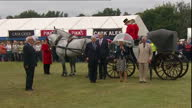 Shows exterior shots Prince Charles Prince of Wales and Camilla Duchess of Cornwall arriving in horse drawn carriage at Sandringham Flower Show as...