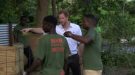 Shows exterior shots Prince Harry visiting the 'Nature Fun Ranch' in Barbados meeting young ranchers at work looking after animals who have come in...