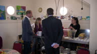 Shows exterior shots Prince William Duke of Cambridge arriving at Spitalfields Crypt Trust drop in centre and interior shtos William talking to...