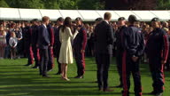 Shows exterior shots Prince William Duke of Cambridge Catherine Duchess of Cambridge and Prince Harry talking to RAF Parachutists before leaving...