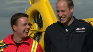 Shows exterior shots Prince William Duke of Cambridge on last day of work as an Air Ambulance Pilot in East Anglia including a photocall with his...
