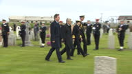 Shows exterior shots Princess Anne and President of Germany Joachim Gauck arriving at Lyness World War I Cemetery on Island of Hoy and standing with...