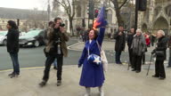 Shows exterior shots proBrexit supporter burning European Union Flag outside the Supreme Court in London while singing Rule Britannia Far away from...