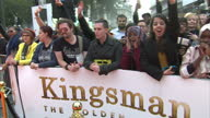 CLEAN Shows exterior shots promotional tshirts being handed out to waiting fans at the World Premiere of 'Kingsman The Golden Circle' held at Odeon...