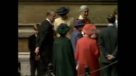 Shows exterior shots Queen Mother accompanied by her granddaughter Lady Sarah ArmstongJones and Prince Philip Duke of Edinburgh accompanied by his...