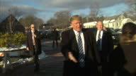 Shows Exterior shots Republican Candidate Donald Trump Arriving at North West Elementary School Polling Station in Manchester New Hampshire Voting's...
