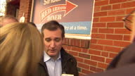 Shows Exterior shots Republican Candidate Ted Cruz surrounded by press outside Red Arrow Diner in Manchester New Hampshire and soundbite on feeling...
