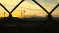 Shows exterior shots security fencing at the Eurotunnel site with sunset in the background on August 1st 2015 in Calais France