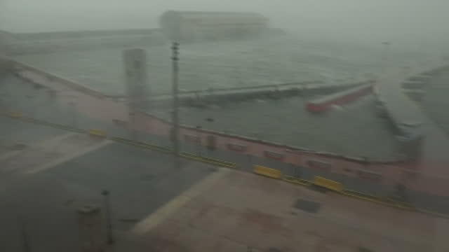 Shows exterior shots strong wind blowing trees and debris around shoreline in San Juan and rain falling as Hurricane Maria arrives with AUDIO...