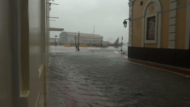 Shows exterior shots strong winds blowing water in flooded street in San Juan ater worst of Hurricane Maria passed Puerto Rico has been hit by the...