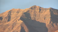 Shows exterior shots sun hitting mountains in the Wasatch Range on October 16 2014 in Salt Lake City UT