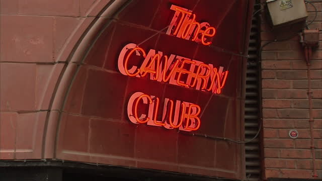 Shows exterior shots the Cavern Club neon signs people waiting outside the entrance to the venue on August 02 2015 in Liverpool England