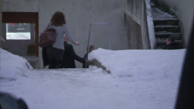 Shows exterior shots Tony Blair being driven in car to the World Economic Forum building walking from car up staircase to door on January 21 2015 in...