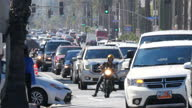 Shows exterior shots traffic driving along busy road in Santa Monica on 26th July 2017 in California USA
