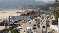 Shows exterior shots traffic driving along the Pacific Coast Highway alongside Santa Monica Beach on 26th July 2017 in Santa Monica California USA