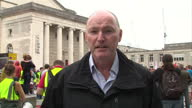 Shows exterior shots UK Labour Party Leader Jeremy Corbyn arriving at rally recieving a Southampton Football Club Shirt on stage and signing...