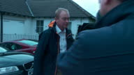 Shows exterior shots UK Liberal Democrats Party Leader Tim Farron leaving home and answering reporters questions Theresa May says she will form a...