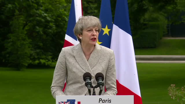 Shows exterior shots UK Prime Minister answering press' question during press conference with President Macron speaking on impact of possible DUPTory...