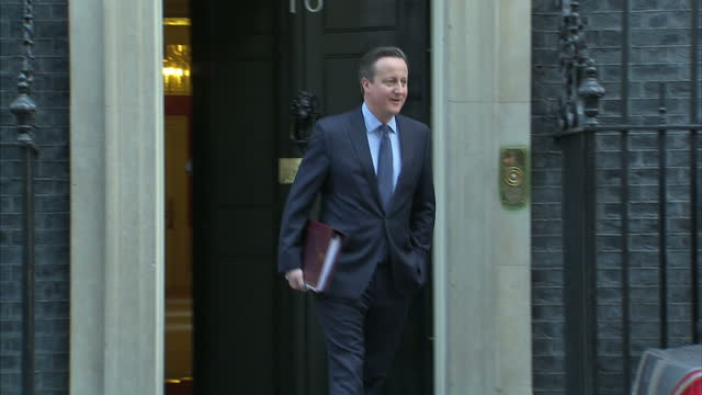 Shows exterior shots UK Prime Minister David Cameron walking out of No 10 Downing Street London getting in car and driving away David Cameron's...