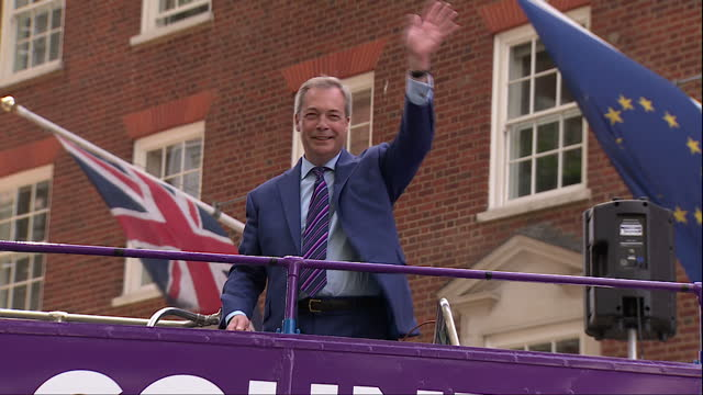 Shows exterior shots UKIP EU Referendum purple Battle Bus with words 'We Want Our country back Vote Leave on June 23rd' written on side arriving and...