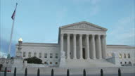 Shows exterior shots United States Supreme Court Building including wide shots statues and carved motto on February 01 2017 in Washington DC