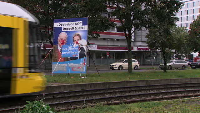 Shows exterior shots various parts of Berline including Reichstag Berliner Fernsehturm and tram and people wlaking in streets in Marzahn suburb...