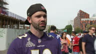 Shows exterior shots voxpop with NFL fan speaking on NFL Football players using sports match to stage political protest against racism and Trump's...
