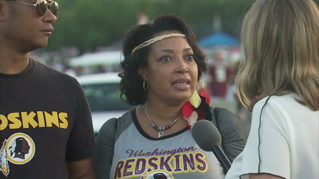 Shows exterior shots voxpops with NFL fan speaking on NFL Football players using sports match to stage political protest against racism and Trump's...