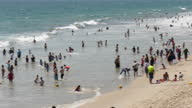 Shows exterior shtos people having fun on the beach and in the sea at Santa Monica Beach on 26th July 2017 in California USA