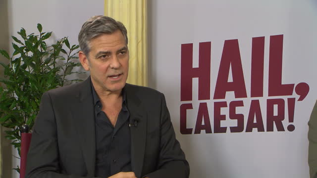 Shows Interior interview with actor George Clooney on meeting Angela Merkel to discuss refugee crisis Exterior shots red carpet premiere of Hail...