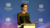 Shows interior shots actress Angelina Jolie Pitt speaking at UN Peacekeeping meeting on need for involvement of women in UN Peacekeeping process...