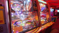 Shows Interior shots Amusement Arcade machine with spinning wheel and WIN button on November 10 2015 in London England