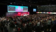 Shows interior shots audience giving Shadow Chancellor John McDonnell a standing ovation after speech as Labour Party Leader Jeremy Corbyn claps on...