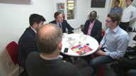 Shows interior shots David Cameron talking with people from Tamoco start up about their products and data security on April 27 2015 in London England