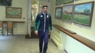 Shows interior shots former England Cricket Captain Alistair Cook walking through corridor at Lord's Cricket Ground and looking at Honours board...