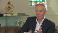 Shows interior shots interview soundbite with former UK Prime Minister Tony Blair speaking on defending his type of politics and centrism QUOTE...