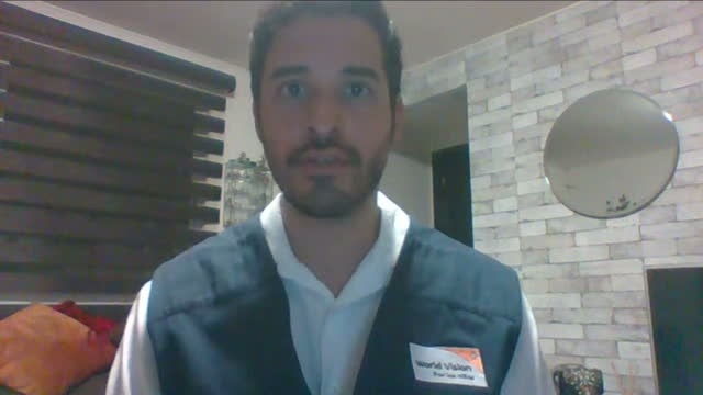 Shows interior shots interview with Specialist in International Relations at World Vision Alejandro Cota speaking on earthquake and people's...