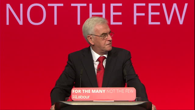Shows interior shots Labour MP Shadow Chancellor John McDonnell making speech at Labour Party Conference with soundbites on renationalising companies...