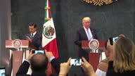 Shows interior shots President of Mexico Enrique Pena Nieto walking onto stage with US Republican Presidential Candidate Donald Trump Interior shots...