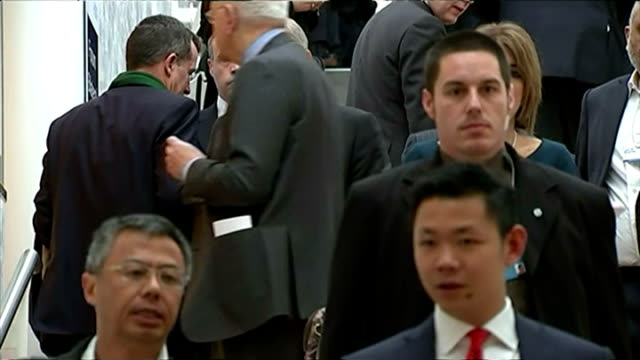 Shows interior shots Prince Andrew walking down staircase talking to people on the way down before walking into conference room on January 22 2015 in...