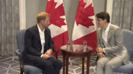 Shows interior shots Prince Harry shaking hands and sitting talking with Canadaian Prime Minister Justin Trudeau during photocall Prince Harry is in...