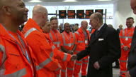 Shows Interior shots Prince Philip Duke of Edinburgh meeting Network Rail employees and saying to one 'you don't sound entirely native where are you...
