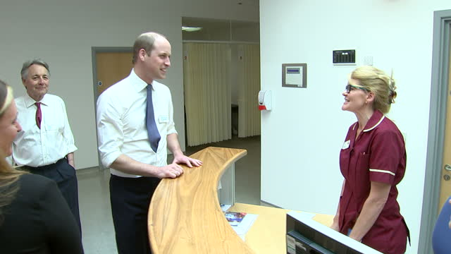 Shows interior shots Prince William Duke of Cambridge talking to staff at Royal Marsden Hospital including Fiona a radiotherapy aid he remembered...