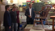 Shows interior shots Prince William Duke of Cambridge talking to service users and volunteers at Restoration Station a woodwork and restoration...