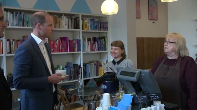 Shows interior shots Prince William Duke of Cambridge visiting Paper Cup a cafe run by the charity Spitalfields Crypt Trust and talking to employees...